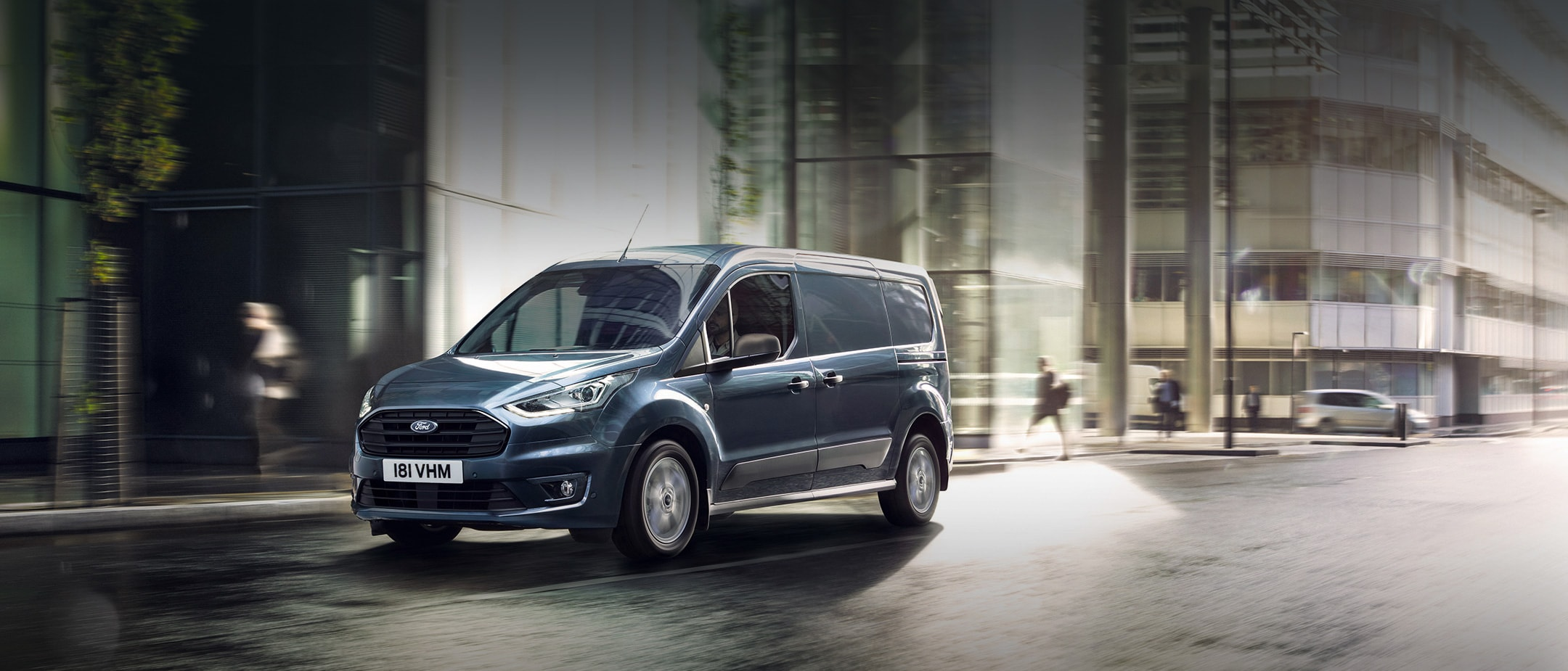 New Blue Ford Transit Connect driving in city