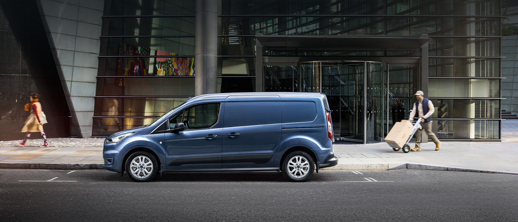 New Blue Ford Transit Connect driving
