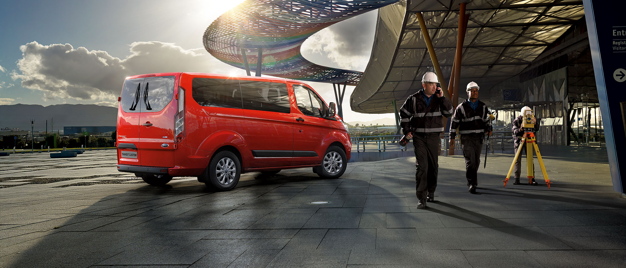 New Red Ford Transit Custom at construction site